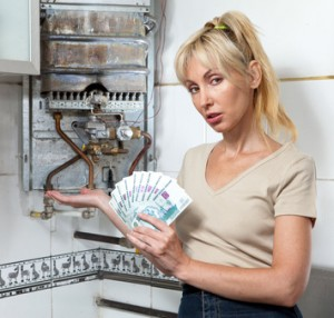 woman housewife counts up money for repair gas water heater..